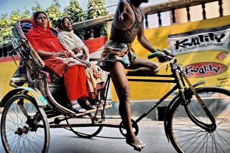 One armed, one legged cycle rickshaw driver