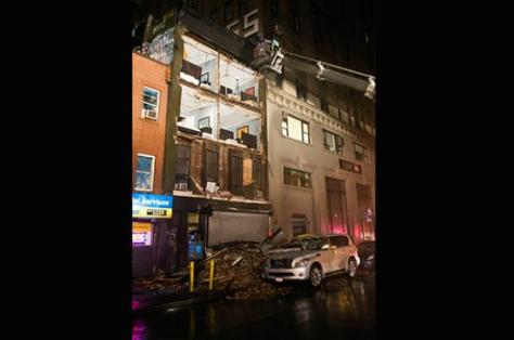 Collapsed facade of a four-story building on 14th