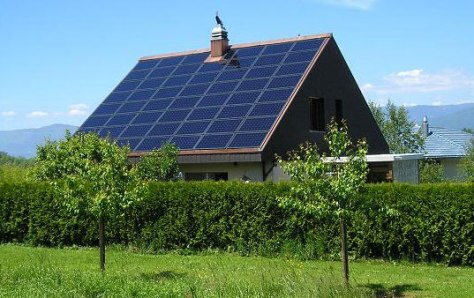 Solar panels on a home.  ALEC will promote legislation planning to penalise individual homeowners who install solar panels.
