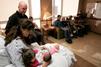 The Smith family welcomes their twelfth child at Mercy Medical Center. The baby girl, Regina, was born around 20 minutes before midnight on Wednesday, December 12, 2012. (Christy Aumer, The Gazette)