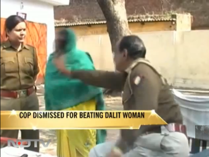 Cop fired for beating Dalit woman