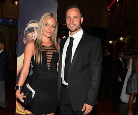 Oscar Pistorius and his girlfriend Reeva Steenkamp pose for a picture in Johannesburg