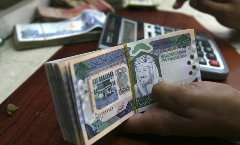 A Saudi money exchanger counts Saudi riyals in Riyadh