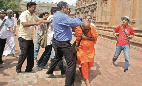 Student Monk  from Sti Lanka roughed up at Brihadeeswarar temple in Thanjavur, Tamilnadu, India.