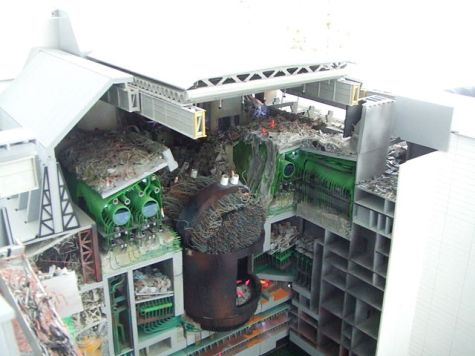 Model of the inside of the Chernobyl nuclear power plant after the disaster. The lid of the reactor (metal, center) was blown off. (Photo from Chernobyl Museum, Kiev, Ukraine.)