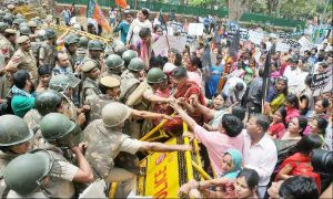 Women activists of BJP remove police barricade outside UPA chairperson Sonia Gandhi's residence during a protest against the rape of of the 5-year-old girl in New Delhi. (Photo: The Time of India)
