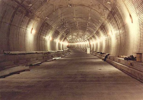 One of the eastbound tubes under construction, March 1984, near the mid-point under the harbor, about 100 feet below the surface of the water. (Photo: roadstothefuture.com)