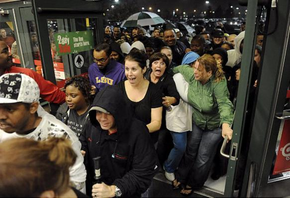 Black Friday Shoppers rushing into the mall.