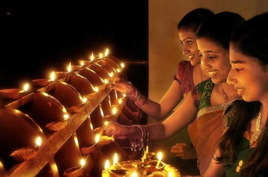 Glow of joy! Women lighting traditional lamps on the eve of Deepavali (Photo:  K.C. Sowmish)