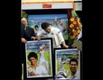 Sachin Tendulkar looks at the fascimile of postage stamps released to honour him. (FE photo - Ravi Kanojia)