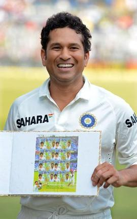 Sachin Tendulkar poses with a stamp book released to commemorate  his last and 200th test match against West Indies at Wankhede Stadium in Mumbai today. (Photo - K.R. Deepak)