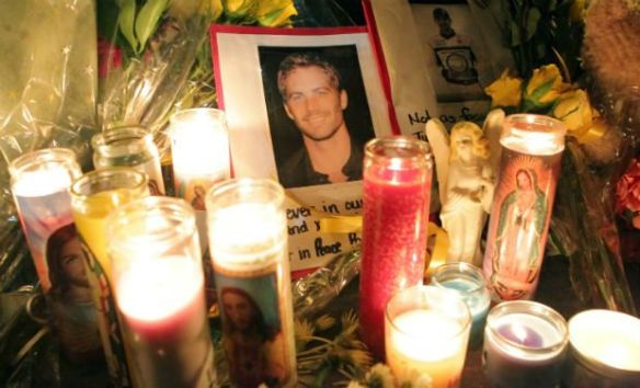 Fans pay tribute to actor Paul Walker at crash site in Valencia, California on December 1 - AFP