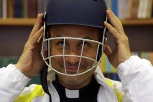 Monsignor Sanchez de Toca y Alameda, undersecretary of the Pontifical Council for Culture, wears a cricket helmet. (AP Photo)