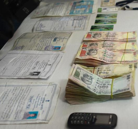The police seized some debit cards from the arrested duo and also recovered Rs. 19,900, which they had obtained in exchange of purchases made with the counterfeit notes. (Photo - B. Jothi Ramalingam - one.in)