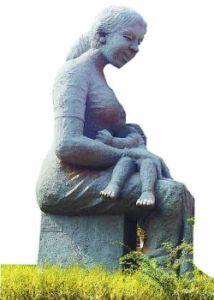 A mother breast-feeding her baby by sculptor Aryanad Rajendran conveys the message of love.
