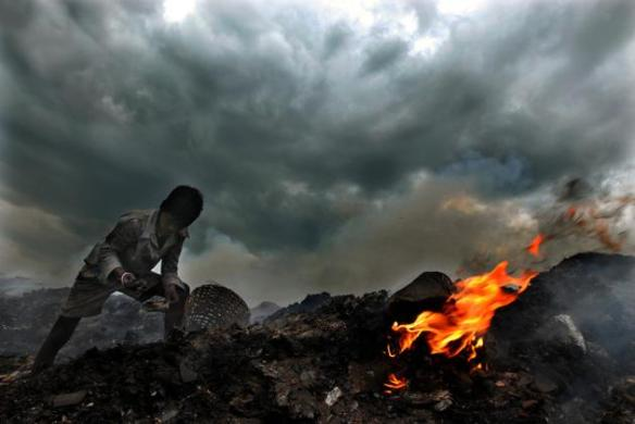 Fires, lit to dispose off the garbage, are a regular and major health hazard.  (Photo: Shaju John/thehindu.com)
