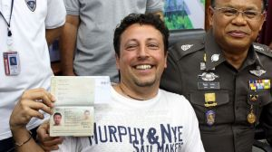 Luigi Maraldi showing his new passport while vacationing in Thailand (Source: abcnews.go.com)