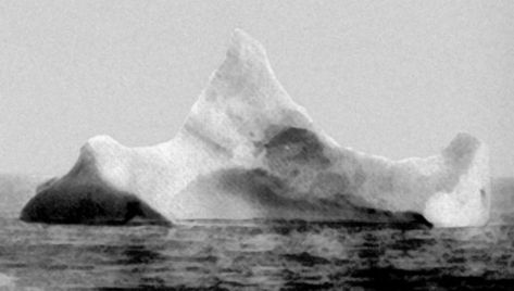 "The iceberg suspected of having sunk the RMS Titanic. This iceberg was photographed by the chief steward of the liner Prinz Adalbert on the morning of April 15, 1912, just a few miles south of where the ""Titanic"" went down. The steward hadn't yet heard about the Titanic. What caught his attention was the smear of red paint along the base of the berg, indication that it had collided with a ship sometime in the previous twelve hours. This photo and information was taken from ""UNSINKABLE"" The Full Story of RMS Titanic written by Daniel Allen Butler, Stackpole Books 1998. Other accounts indicated that there were several icebergs in the vicinity where the TITANIC collided."