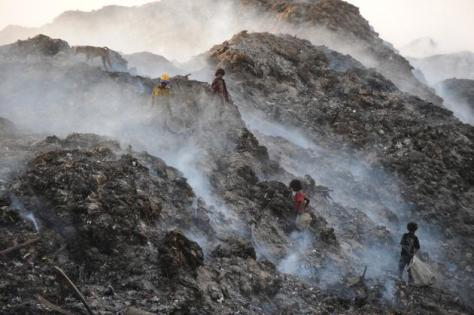 The smoke from the garbage heaps chokes the air for miles around.  (Photo: Shaju John/thehindu.com)