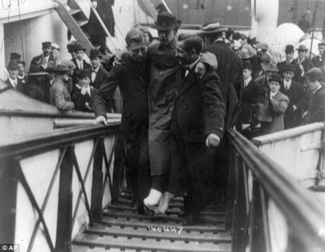 In this 1912 photo made available by the Library of Congress, Harold Bride, surviving wireless operator of the Titanic, with feet bandaged, is carried up the ramp of RMS Carpathia