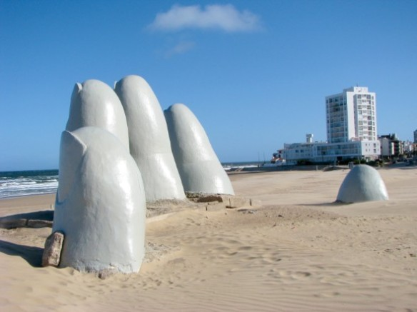 A giant sculpture of a hand reaching out of the sand at Punta del Este, Uruguay (Source: thetextbiz.com)