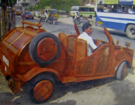 Appar Lakshmanan drives the car he made almost entirely with wood (Source: DC)