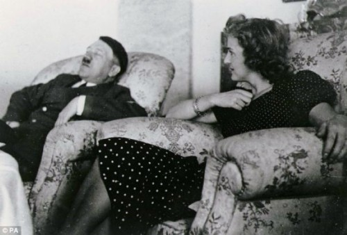 Adolf Hitler asleep, next to Eva Braun - this photo was banned during Hitlers lifetime. (Source:  dailymail.co.uk)