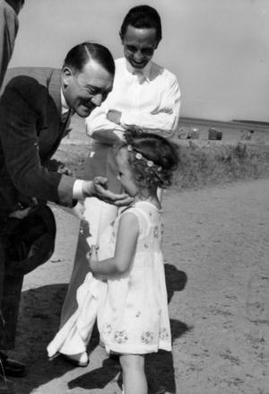 Adolf Hitler with  Goebbels'  first daughter, Helga (born September 1, 1932), in Heiligendamm in 1933.