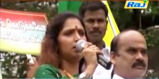 Bhuvaneswari speaking at a political meeting.