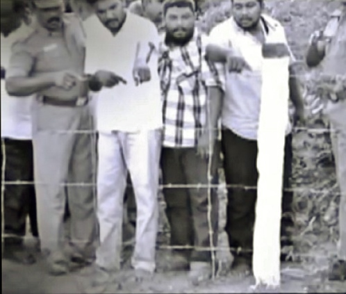 Umachandran's accomplices showing the spot where they buried  the body of Ronald Peter Prinzo.
