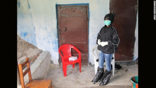 Fatu Kekula, 22-year-old Liberian student nurse. She took all the precautions for avoiding contact by using layers of trash bags on her feet and hair. She wore rubber boots, four pairs of gloves, and a face mask. (Source: edition.cnn.com)