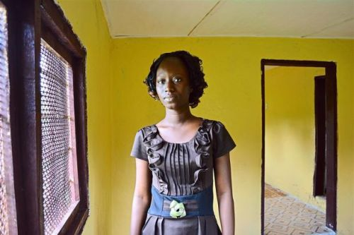 Fatu Kekula, 22-year-old Liberian student nurse  saved her father's life in this makeshift isolation ward in a spare unfinished room at home. - MCT