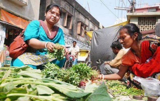 Pinky Das, a housewife from Kolkata, buys vegetables for her household. (TOI file photo by Sayantan Ghosh)