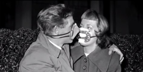 People wore face masks even to kiss.