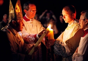Lighting the Paschal Candle (Source: catholiccourier.com)