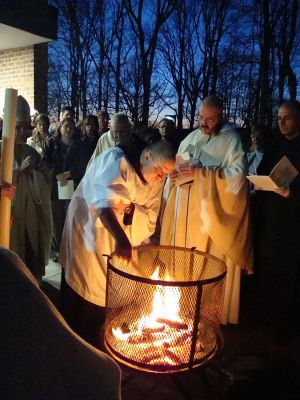 Roman Catholic monks of the Order of Saint Benedict preparing to light the Christ candle prior to Easter Vigil mass at St. Mary's Abbey in Morristown, New Jersey. (Photo: John Stephen Dwyer)