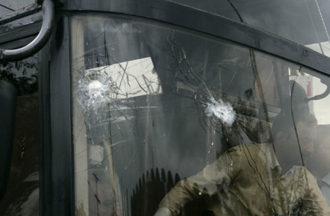 Bullet holes in the windscreen of the Sri Lankan team coach (Photo: K.M. Chaudary/AP)