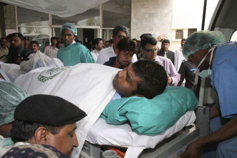 Pakistan hospital staff carry Sri Lankan cricket player Tharanga Paranavitana (Source: abc.net.au)
