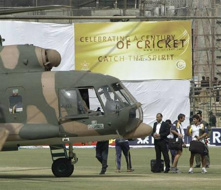 Sri Lankan cricket team officials and players prepare to board a helicopter at the Gaddafi stadium (Source: in.reuters.co