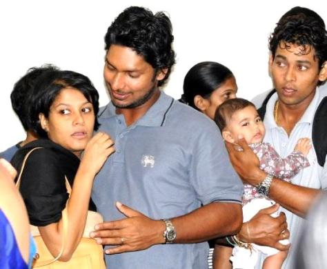 Back in Paradise. Sri Lankan cricketer Kumar Sangakkara hugs his wife Yehali and Tillakaratne Dilshan holds his son upon their return to Colombo on March 4. (Source: cricbuzz.com)