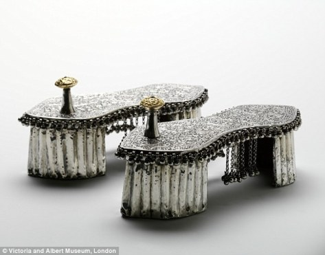 An antique wedding silver and gold over wood, toe-knob paduka, of the 1800s exhibited in the Victoria and Albert Musueum, London.