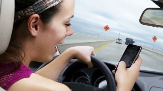 Texting while driving (Source: ryot.org)