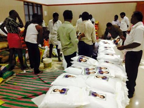 AIADMK cadres sticking stickers of JJ (Source: Dinakaran.com)