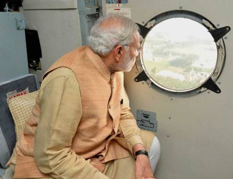 PM Narendra Modi viewing flooded Chennai from a helicopter (Source: financialexpress.com)